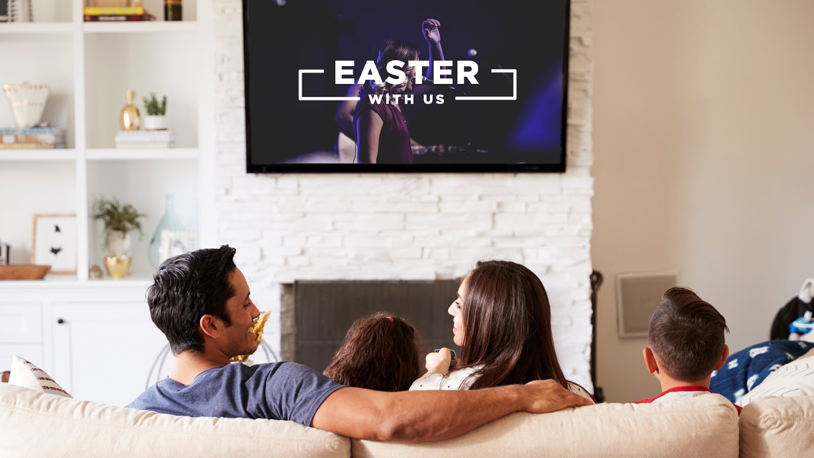 Family at home streaming a church service on their TV